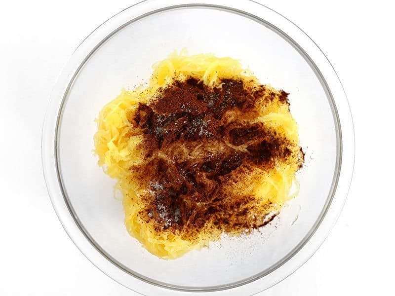Seasoning added to Spaghetti Squash in a glass bowl
