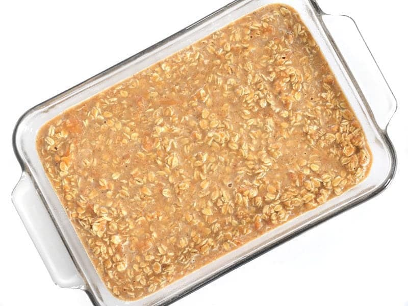 Sweet Potato Casserole ready to bake in a glass casserole dish