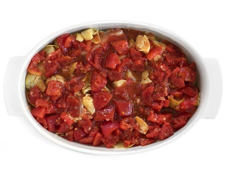 Diced Tomato mixture poured over Chicken in the casserole dish