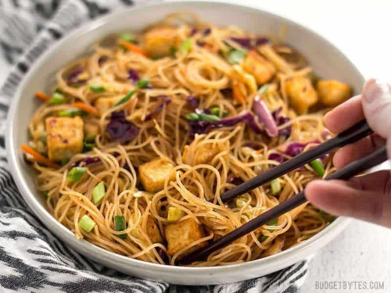These Singapore Noodles with Crispy Tofu have a bold flavor and vibrant colors thanks to shredded vegetables and a bright curry sauce. BudgetBytes.com