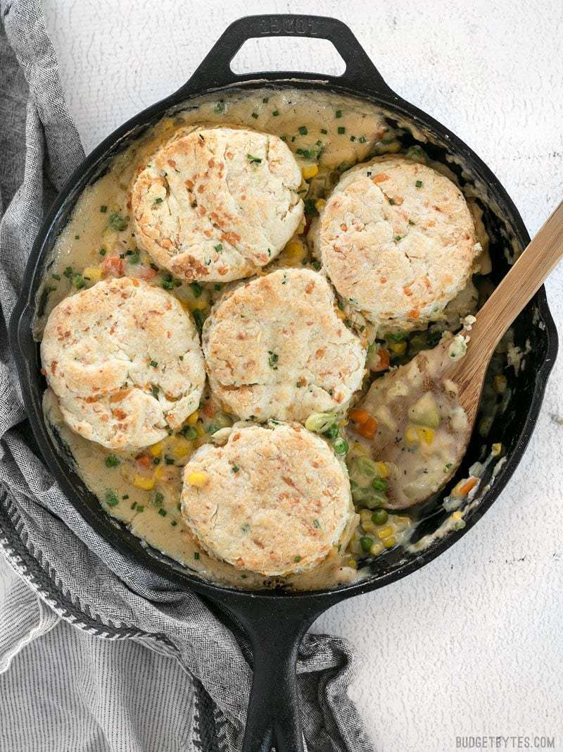 Skillet full of warm and comforting Vegetable Pot Pie Skillet with Cheddar Biscuit Toppings
