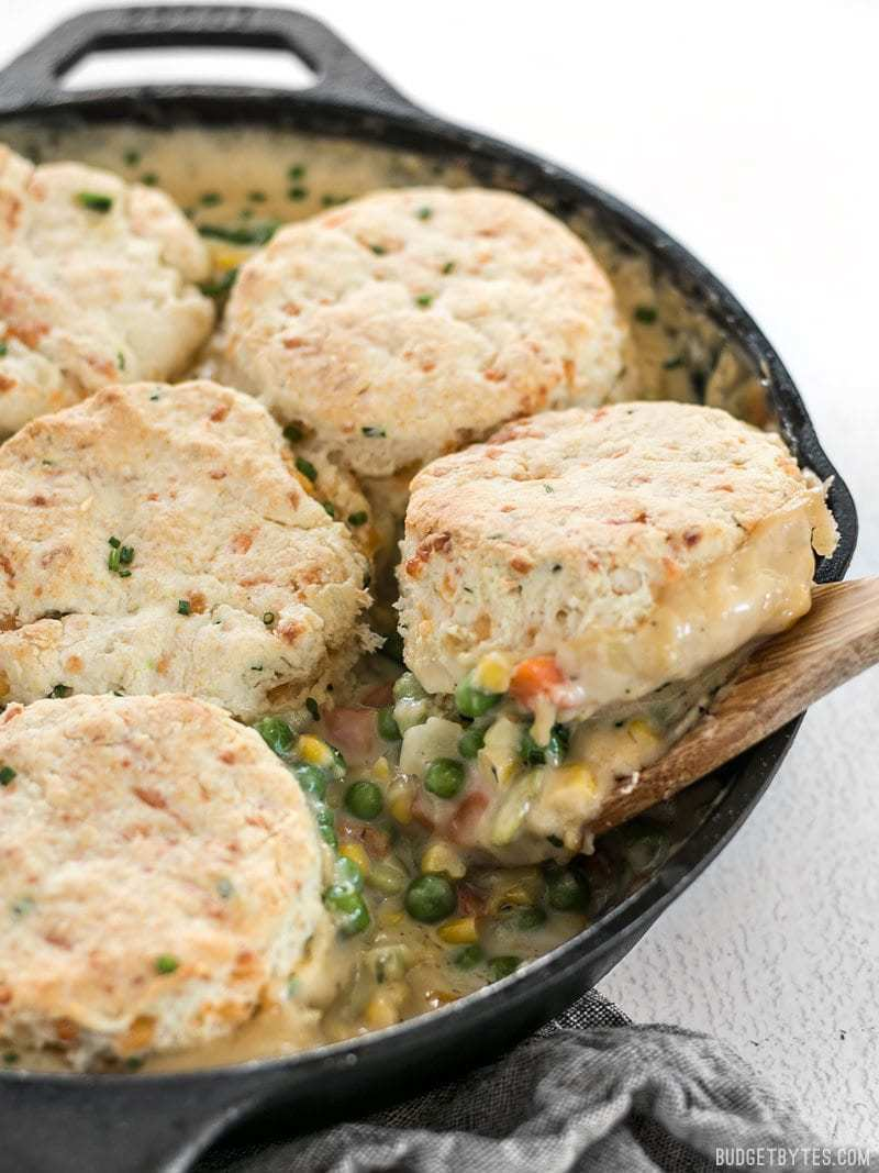 Side shot of the Vegetable Pot Pie Skillet with a scoop of Cheddar Biscuit Topping
