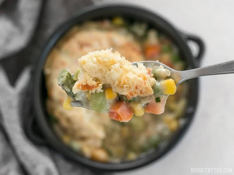 A forkful of warm and comforting Vegetable Pot Pie Skillet and Cheddar Biscuit