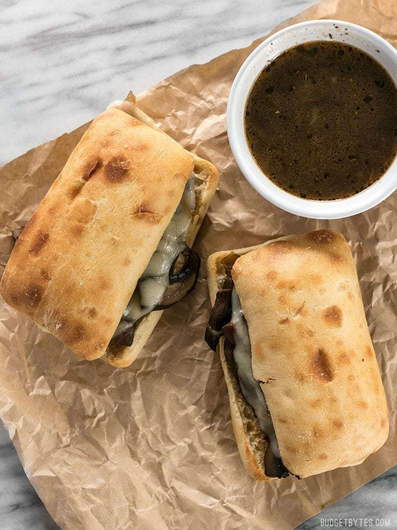 These Vegetarian French Dip Sandwiches are fast, easy, and feature a salty-sweet herb infused vegetarian au jus for dipping. BudgetBytes.com