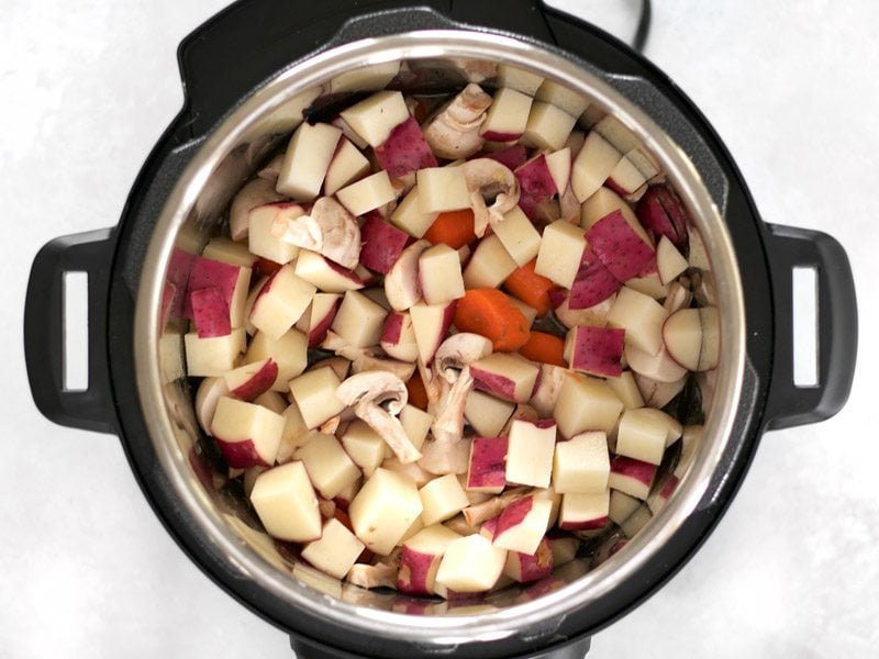 Add Vegetables to the Instant Pot with Beef and Broth