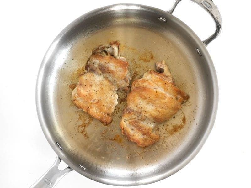 Browned Chicken Thighs in the skillet