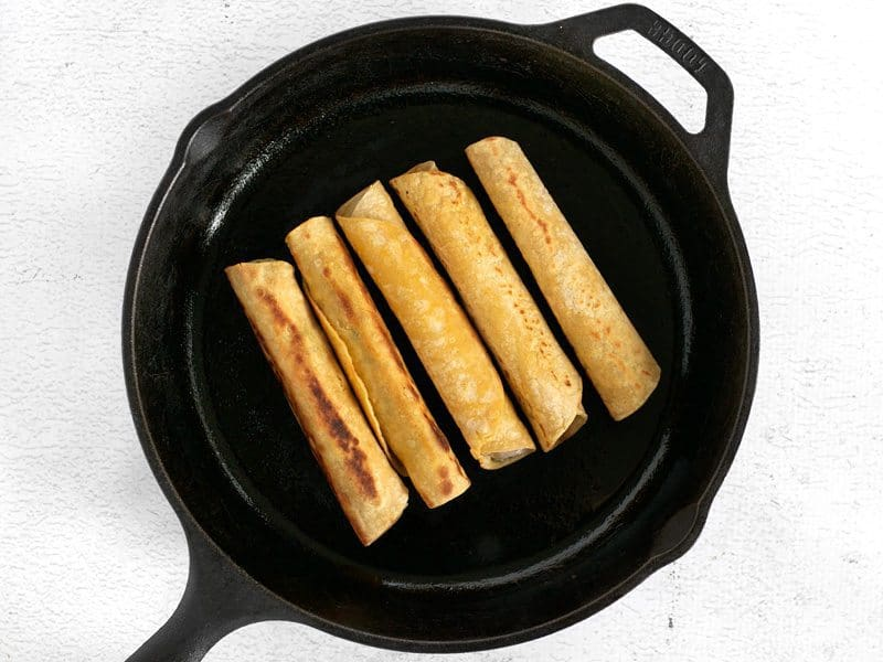 Cooking Taquitos in a cast iron skillet