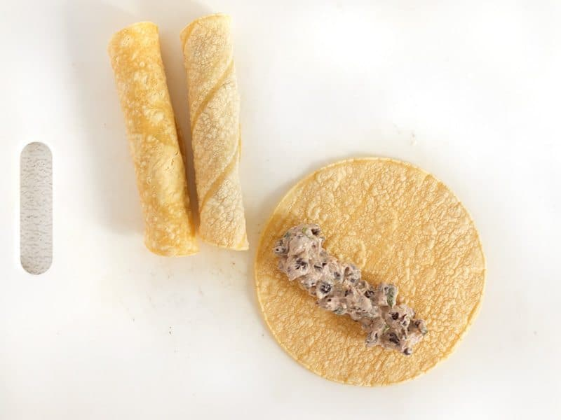 Fill Tortillas and roll into a cigar shape