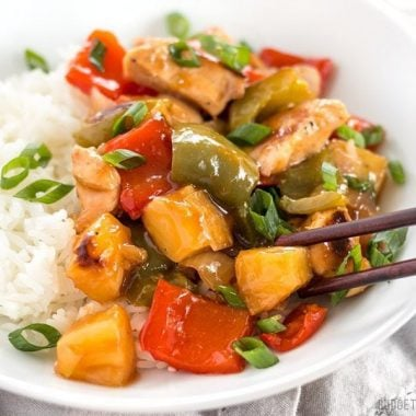 This oven baked Sheet Pan Sweet and Sour Chicken is a little more forgiving than a fast moving, high heat stir fry, making it great for beginners! BudgetBytes.com