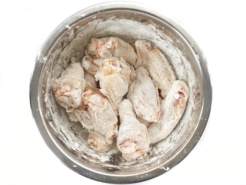 Chicken Wings Coated in Cornstarch in a bowl