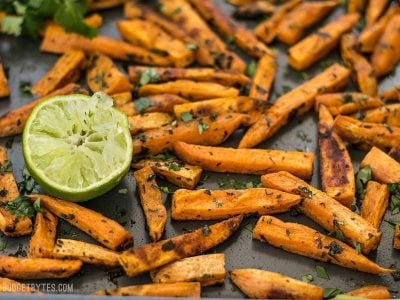 Bright lime juice and earthy cumin pair perfectly with the subtle creamy sweetness of sweet potatoes in these Cumin Lime Roasted Sweet Potatoes. BudgetBytes.com
