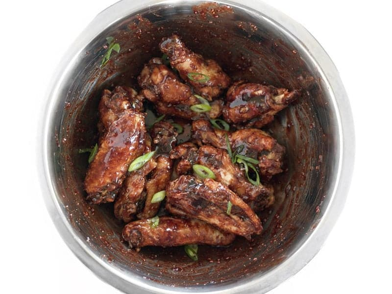 Wings Tossed in Glaze, topped with sliced green onions