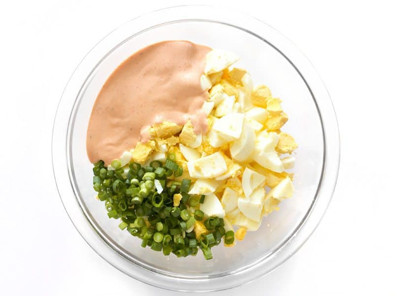 Combine Eggs Onion and Salad Dressing