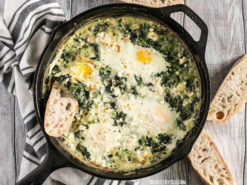 Make these fast and easy Creamed Spinach Baked Eggs using items you probably have in your pantry. A little feta on top takes it to the next level! BudgetBytes.com