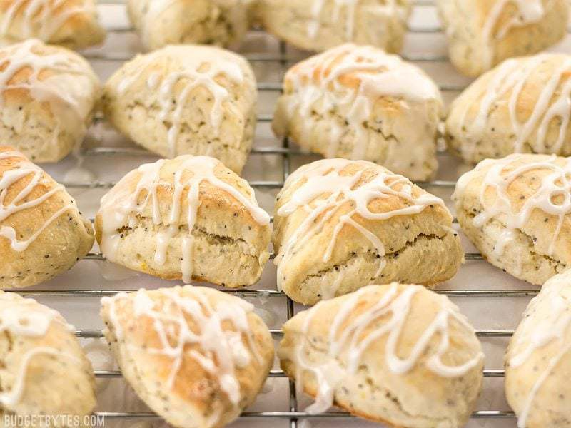 These cute little lemon poppy seed two-bite scones are soft and sweet with a deliciously tart lemon glaze. You won't be able to have just one! BudgetBytes.com
