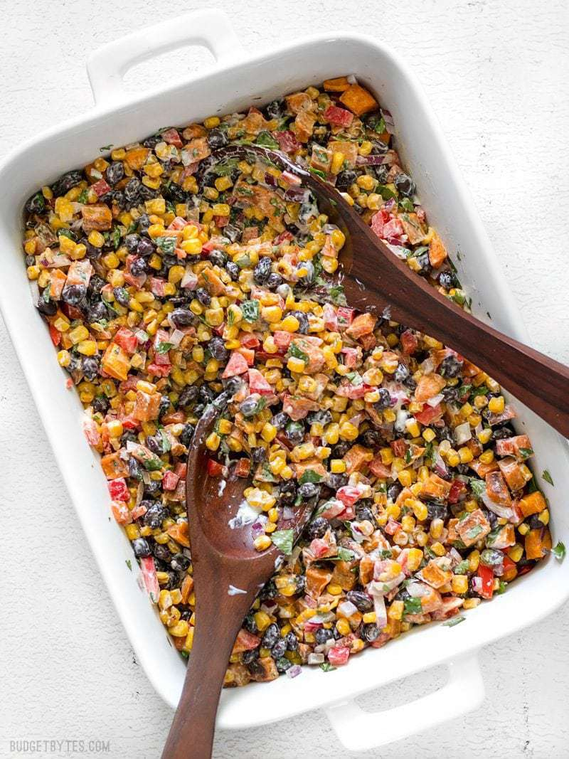 This Roasted Sweet Potato Rainbow Salad combines a medley of vibrant colors and flavors, brought together by a bright and creamy dressing. BudgetBytes.com