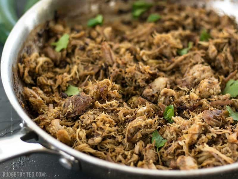 Close up of slow cooker carnitas that have been crisped in a skillet