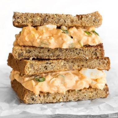 Sriracha Egg Salad is a simple yet satisfying dish that boasts a creamy, tangy, and spicy sauce. BudgetBytes.com