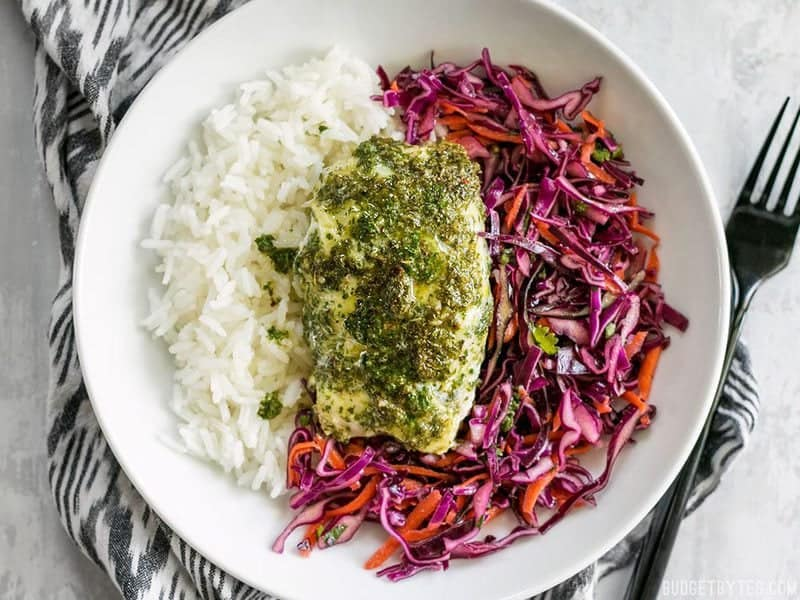 These light and fresh Baked Chimichurri Fish Bowls are simple to prepare and make great cold lunches for the rest of the week. BudgetBytes.com