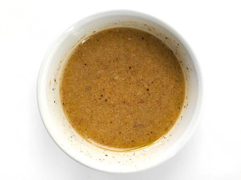 Homemade Mustard Vinaigrette in a small white bowl