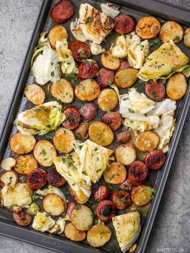 This One Pan Roasted Kielbasa and Cabbage Dinner comes together in minutes and is full of flavor and comfort. An easy weeknight dinner! BudgetBytes.com