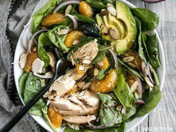 This meal-worthy Chicken and Mandarin Salad boasts sweet mandarin oranges, creamy avocado, crunchy almonds, and homemade sesame dressing. BudgetBytes.com