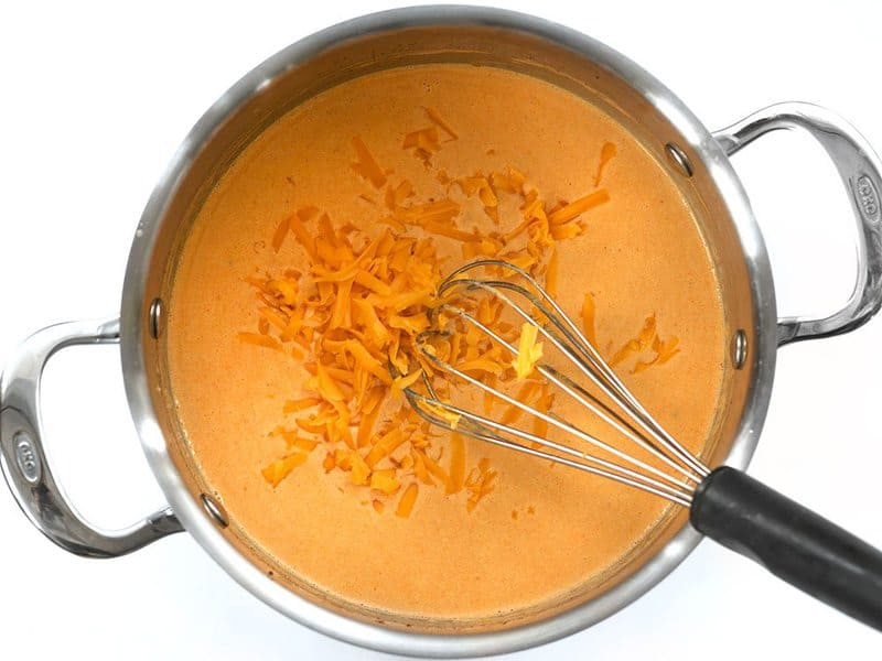 Melt Cheddar into the sauce