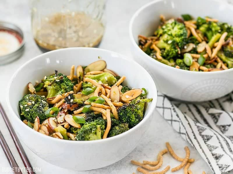 Side view of two bowls of Roasted Broccoli Salad with Almonds