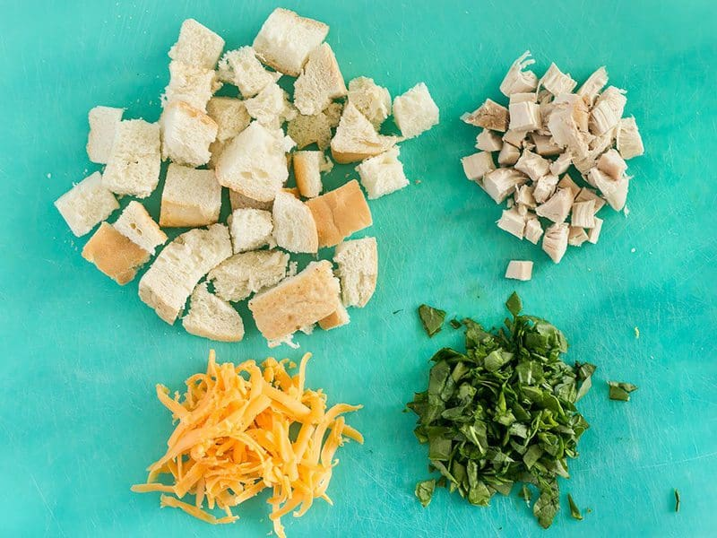 Savory Breakfast Mug Dry Ingredients - Cubed bread, cubed chicken, cheddar, and parsley