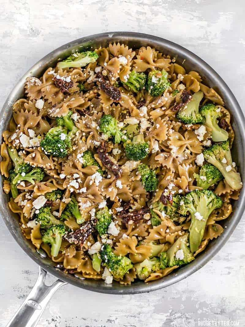 A few pantry staples come together to make a fantastic dinner in this fast, easy, and flavorful one Skillet Pasta with Sun Dried Tomatoes Walnuts and Feta. BudgetBytes.com