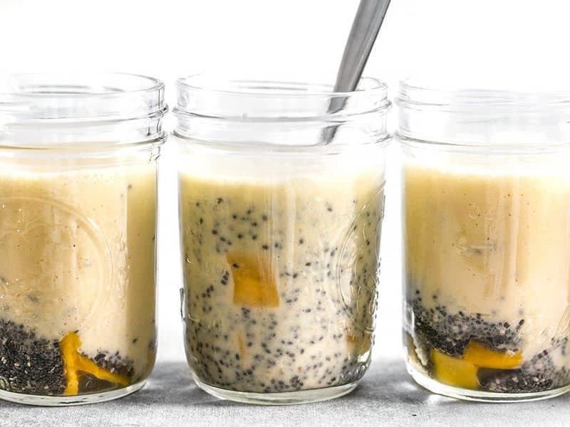 Stir Mango Coconut Chia Pudding in jars