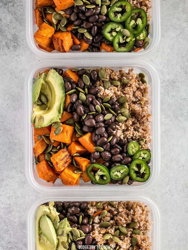 These Sweet Potato Grain Bowls with Green Tahini Sauce are prefect for meal prep and bursting with color, texture, and flavor! BudgetBytes.com