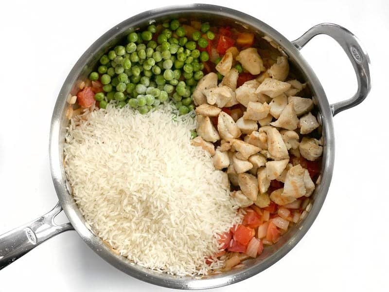 Add Rice Chicken and Peas to the skillet
