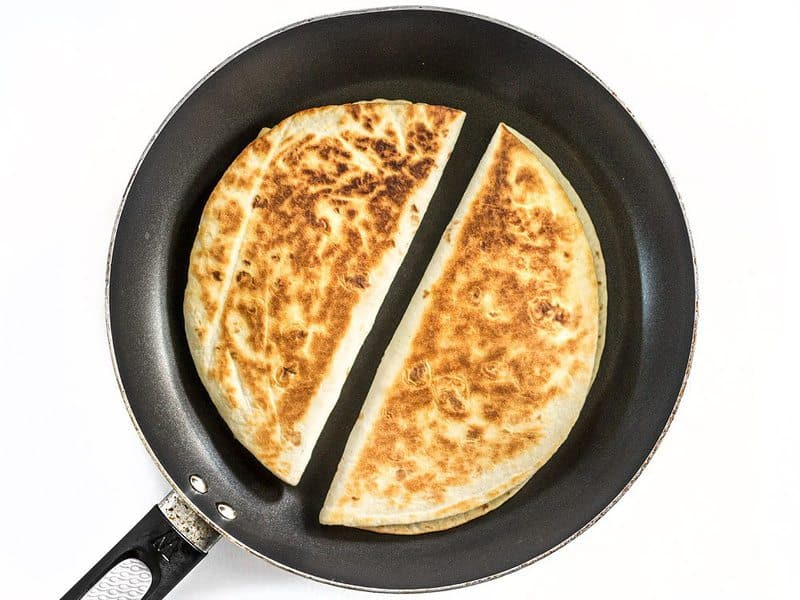 Roasted Corn Quesadillas being toasted in a skillet