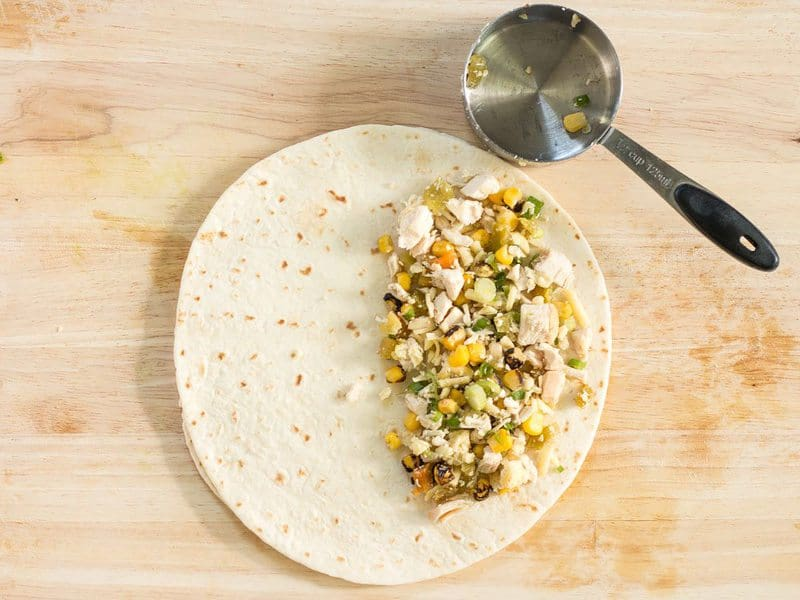 Place corn filling in tortilla
