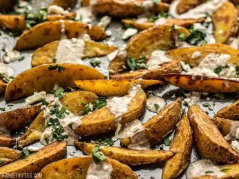 These simple Roasted Potato Wedges are the perfect vehicle for this creamy, garlicky shawarma sauce and crumbled feta. BudgetBytes.com