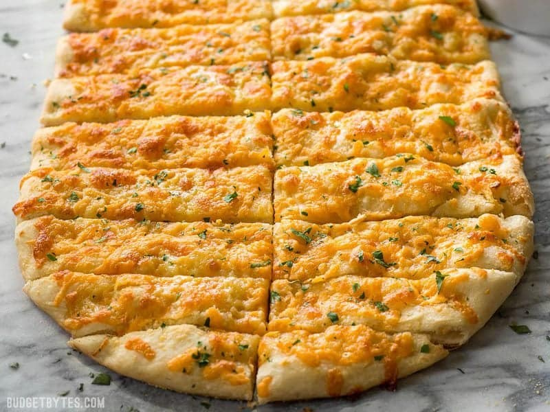 This Homemade Cheesy Garlic Bread is the real deal with homemade dough, fresh garlic, real butter, and your favorite cheese. BudgetBytes.com