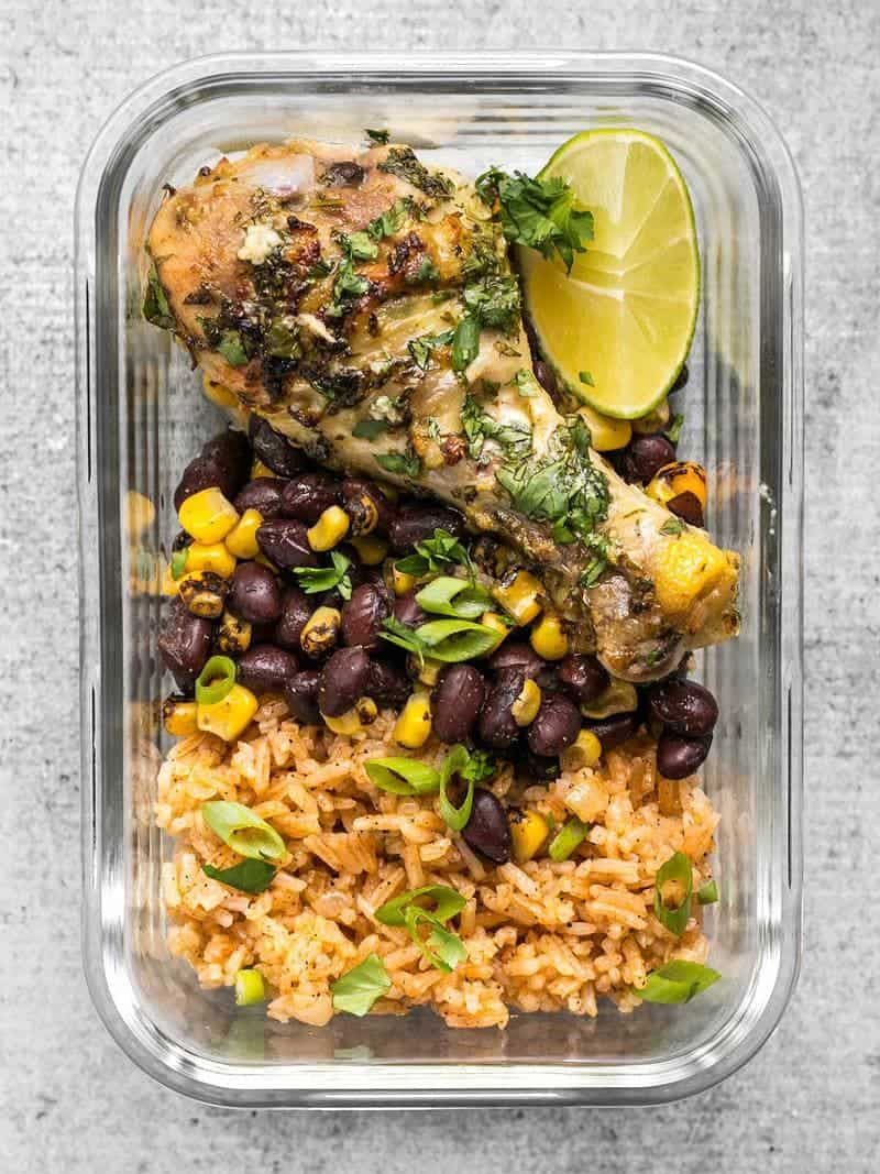 Bright and flavorful Cilantro Lime Chicken plus a classic Taco Rice and a smoky mix of corn and black beans makes an easy and hearty meal. BudgetBytes.com