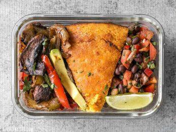 This smoky chipotle portobello fajita meal prep features mixed fajita vegetables, sweet potato cornbread, and cowboy caviar for a filling vegetarian meal! BudgetBytes.com