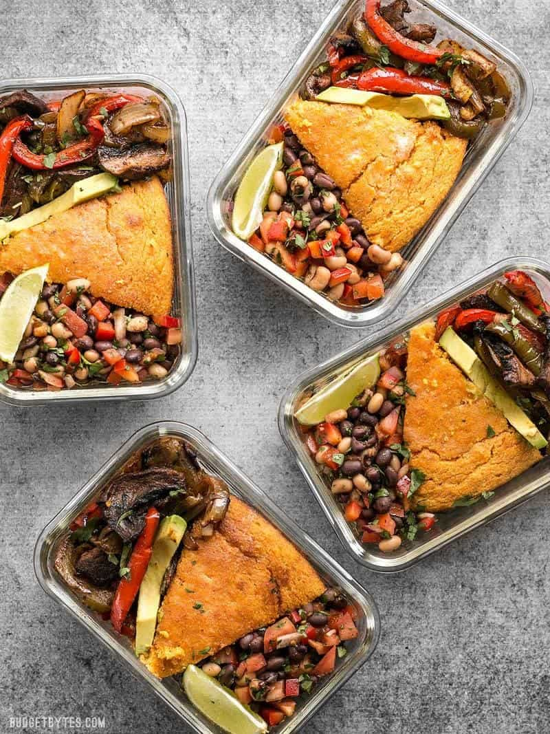 This smoky chipotle portobello fajita meal prep features mixed fajita vegetables, sweet potato cornbread, and cowboy caviar for a filling vegetarian meal! BudgetBytes.com