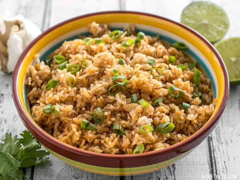This flavorful Taco Rice is packed full of herbs and spices, but is neutral enough to serve as the base for several different recipes, like bowl meals, burritos, and more! BudgetBytes.com