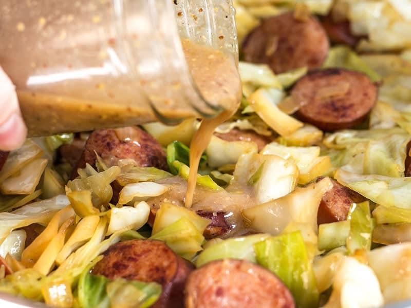 Add Mustard Vinaigrette to Kielbasa and Cabbage Skillet