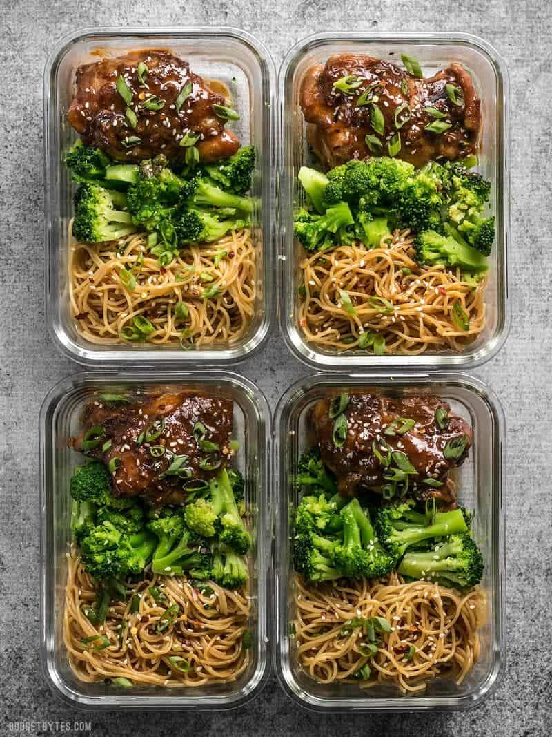 Four glass Sticky Ginger Soy Glazed Chicken Meal Prep containers side by side