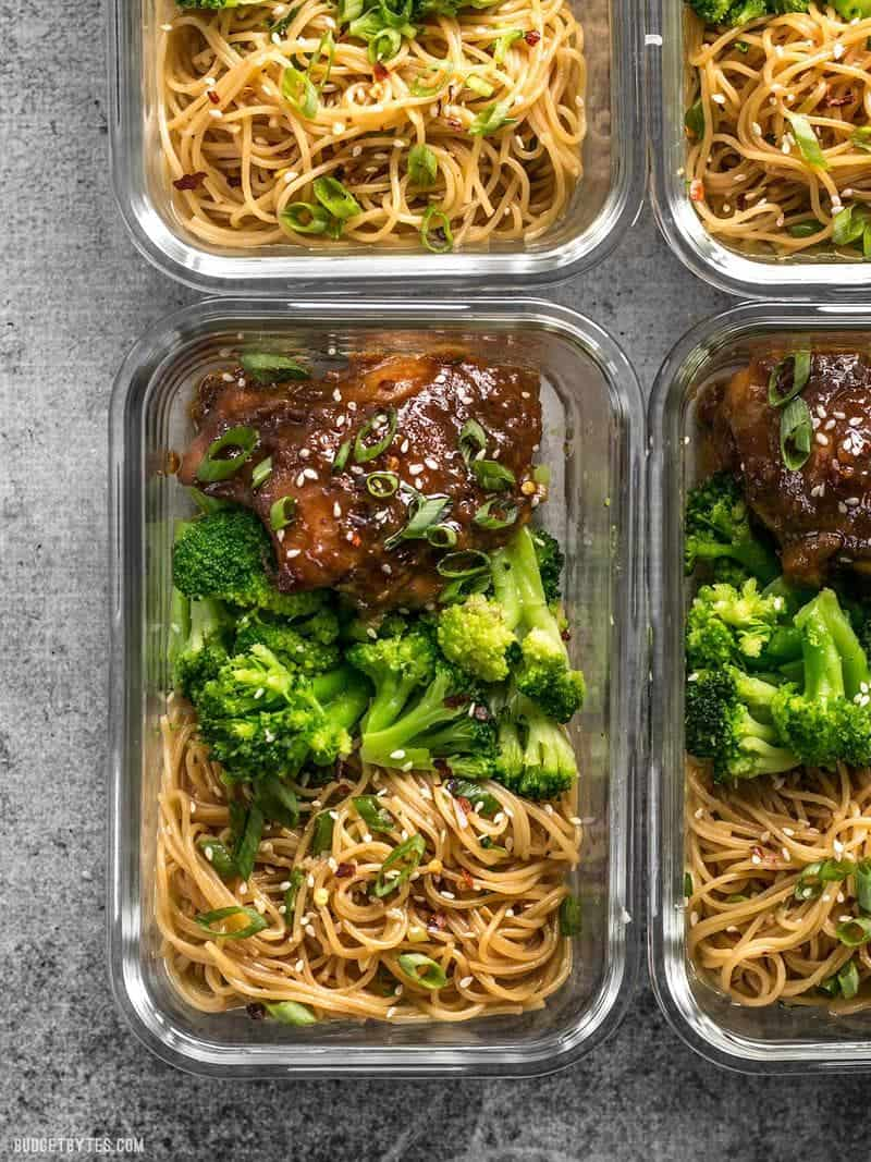 Four glass Sticky Ginger Soy Glazed Chicken Meal Prep containers close up