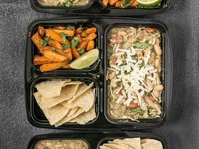 This White Chicken Chili Meal Prep includes a slow cooker chili with Cumin Lime Roasted Sweet Potatoes and tortilla chips for dipping! BudgetBytes.com