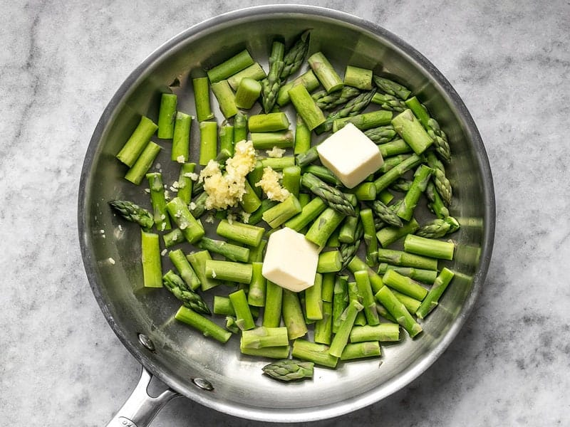 Add Butter and Garlic to skillet with asparagus