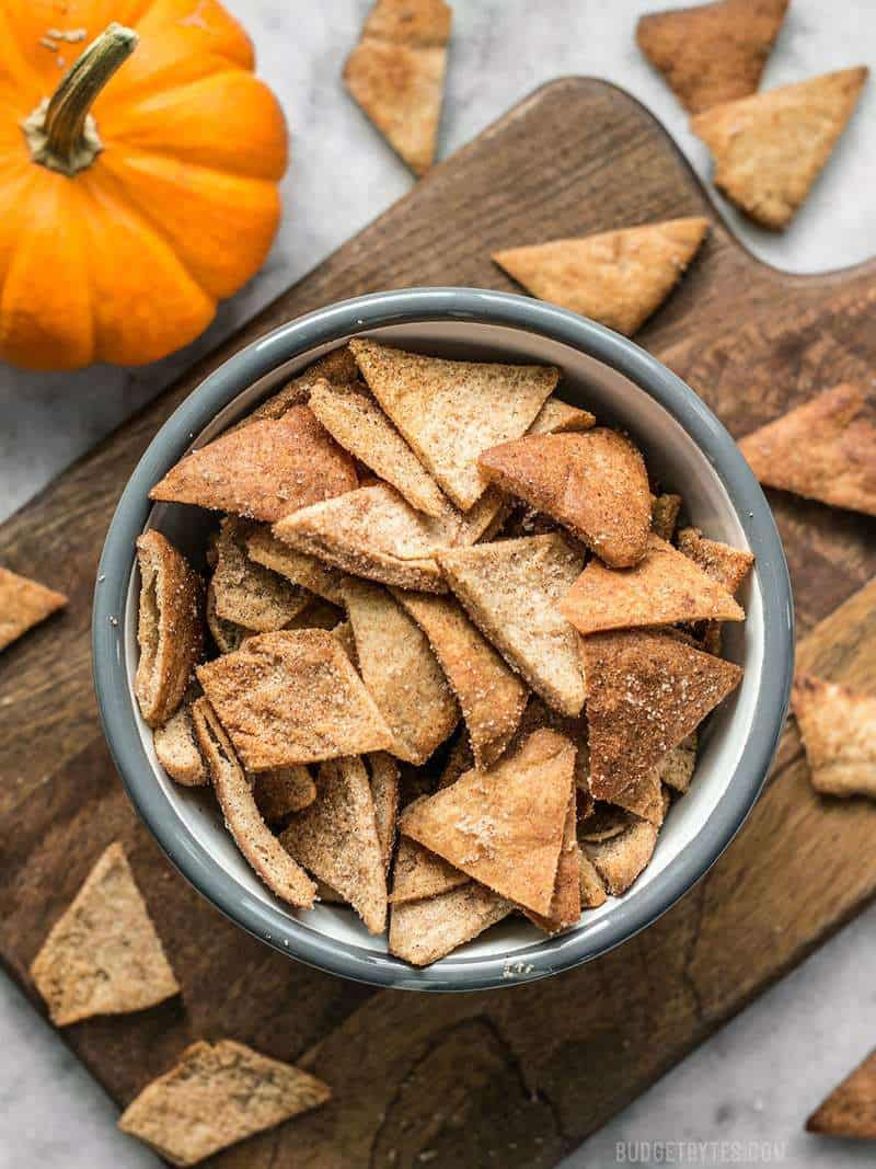 These Cinnamon Pita Crisps are a tasty little snack that's perfect for fall. Dip them into your favorite sweet treat or eat them on their own. BudgetBytes.com