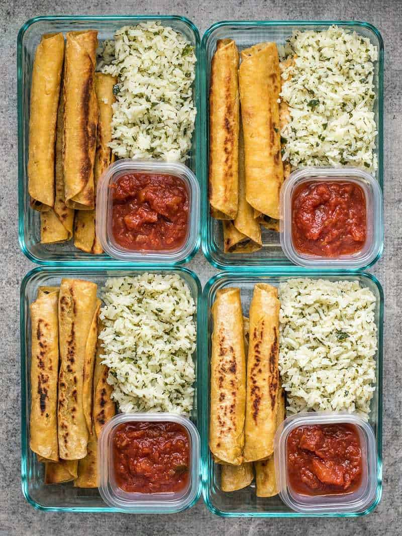 Four Creamy Black Bean Taquito meal prep containers with salsa and cilantro lime rice