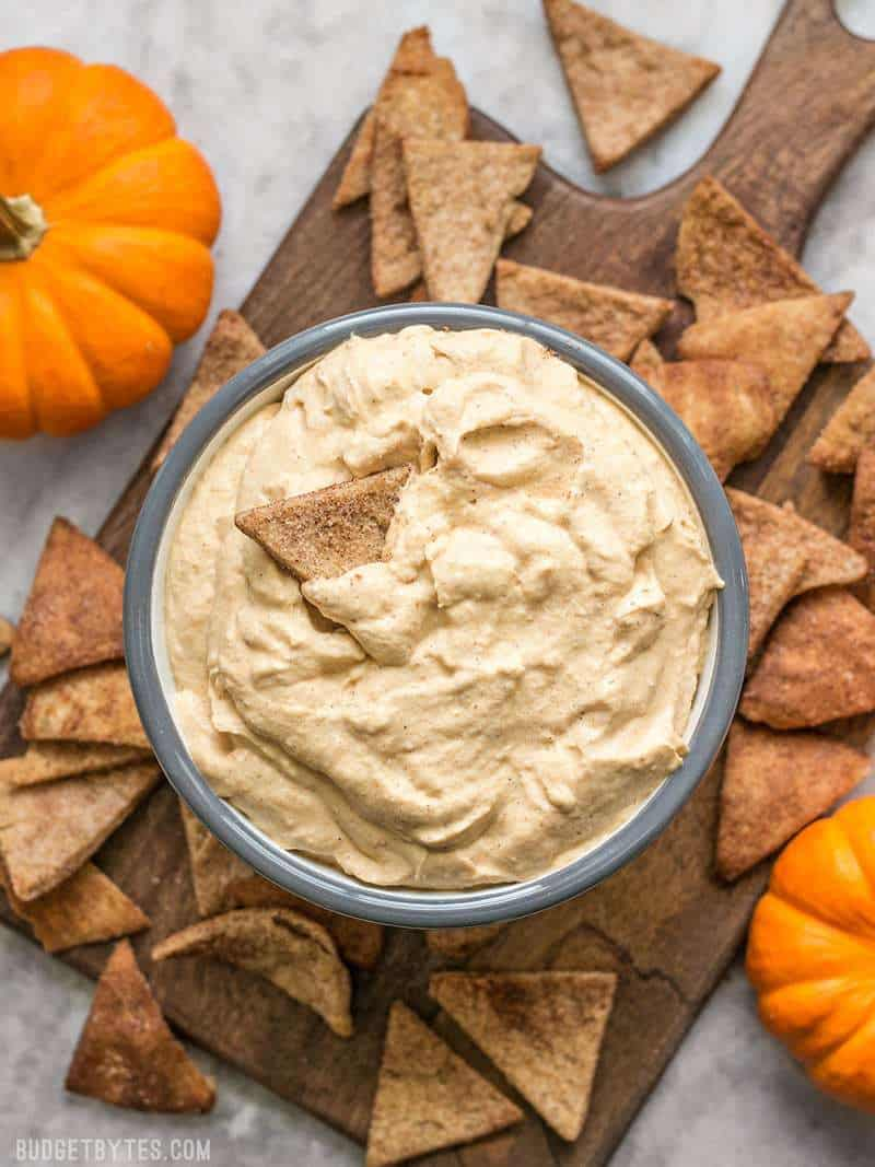 A full bowl of fluffy Pumpkin Cheesecake Mousse with Cinnamon Pita Crisps for dipping.