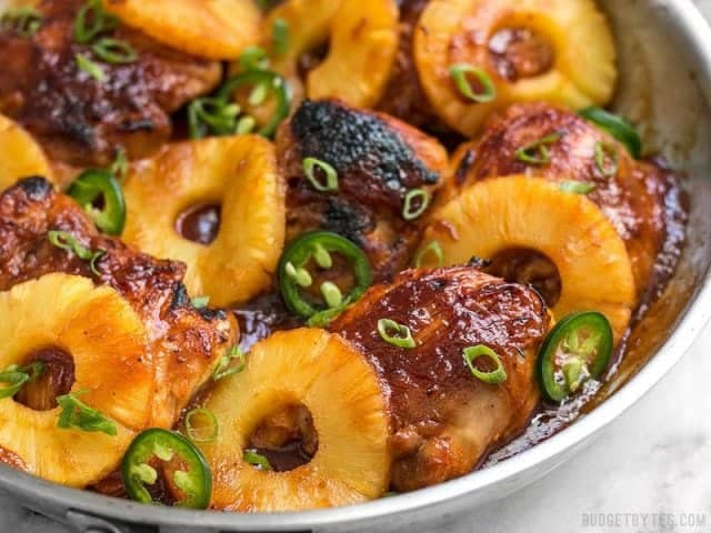 A quick pan sauce drenches tender chicken thighs and thick pineapple slices in this easy Skillet Pineapple BBQ Chicken. BudgetBytes.com